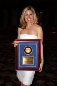 Lauren Reynolds accepting journalism award.